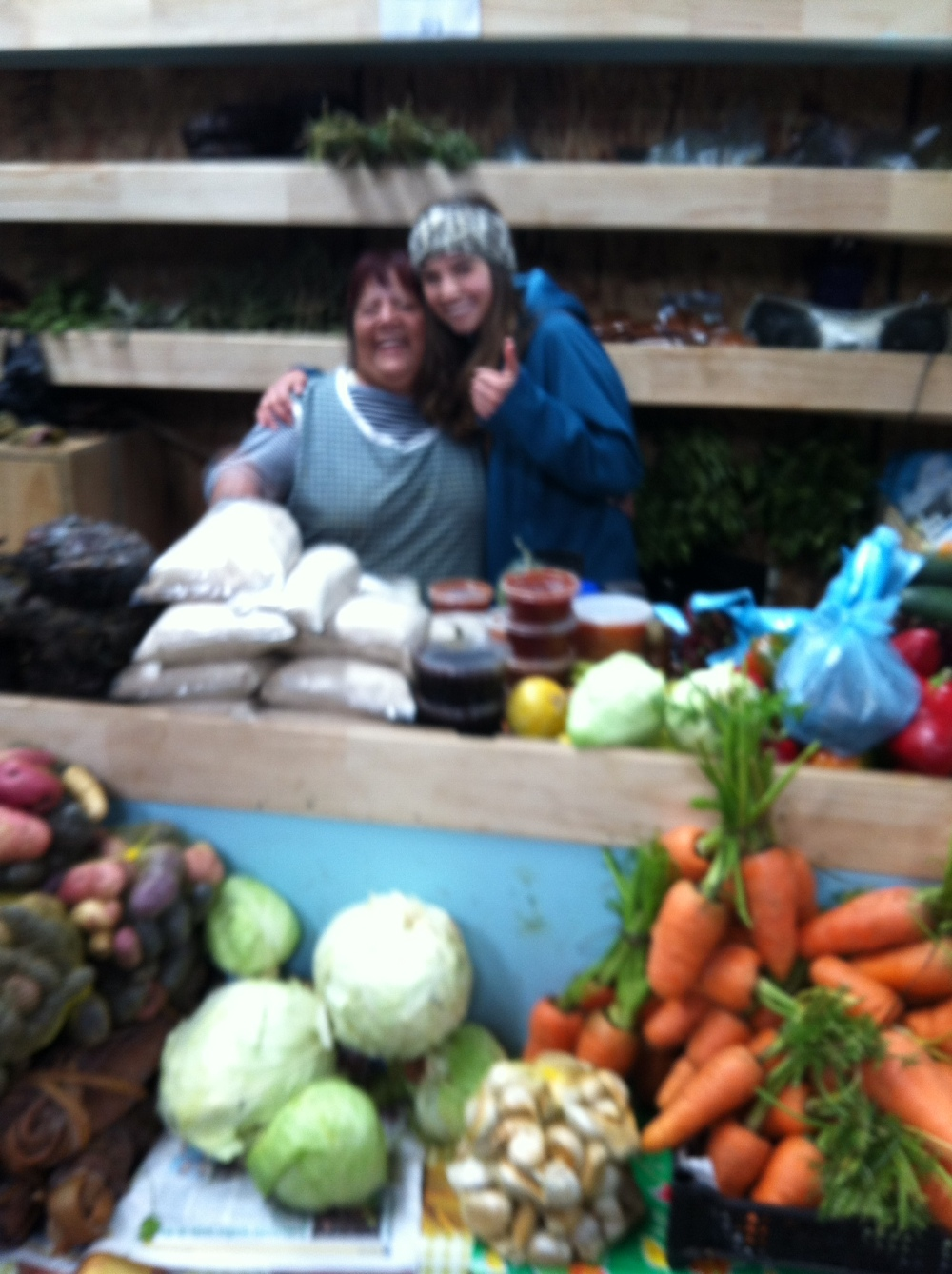 Blury selfie of the Chilote woman and myself as we bonded over selling fresh vegetables and a love of the rain. We both agree: it does have a smell.